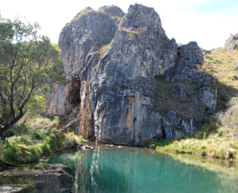 The water in Blue Waterholes has a strong blue cast as a result of the minerals dissolved from the limestone