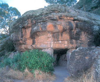 Entrance to the hermit cave set in the sedimentary rocks of McPhersons Range