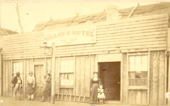 Ellen Dillon and daughter in front of Michael Dillon's Hotel and butcher Alfred Blanchard standing near the lamp post, Mayne Street, Gulgong, 1872 or 73. Photo courtesy of National Library of Australia