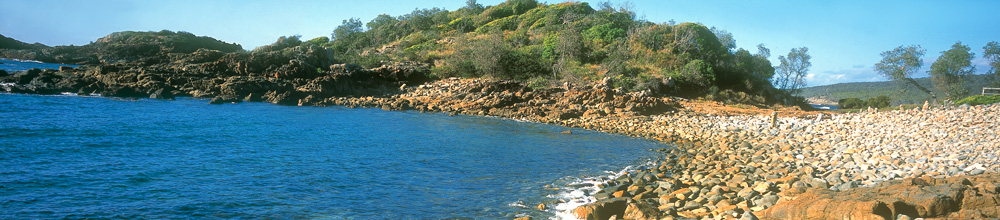 The bolder beach at Mimosa Rocks. The boulders strewn on the foreshore are weathered columnar rhyolite